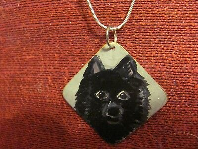 Schipperke hand painted on thin, squarem metal pendant/bead/necklace