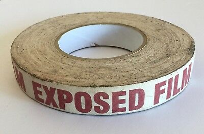 "Red ""EXPOSED FILM"" white FABRIC ADHESIVE TAPE ROLL 1"" wide 6.25""dia Movie Prop"