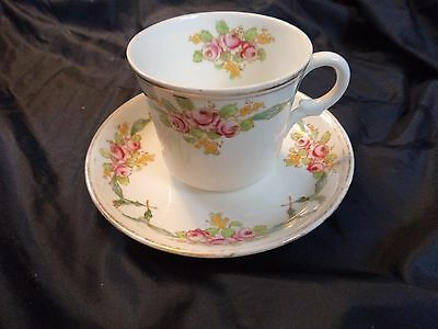 vintage Sutherland china cup and saucer hand coloured roses