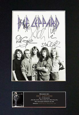 DEF LEPPARD - Signed By All 5 Band Members ! / Classic Autographed Photograph