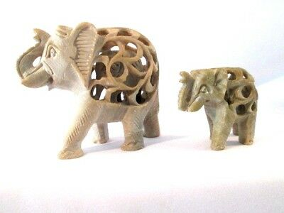 TWO Elephant Figurines Carved Soapstone Intricate Baby Inside