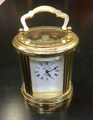 L'EPEE OVAL BRASS CARRIAGE CLOCK. 8 DAY. IN VERY GOOD CONDITION w KEY.