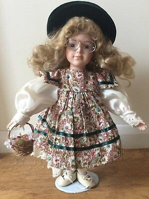 Porcelain Doll Curly Blonde Hair, Glasses, Hat, Basket of Flowers on Stand