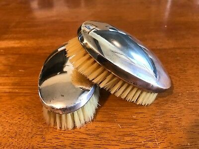A pair of Antique Silver Mounted Hairbrushes