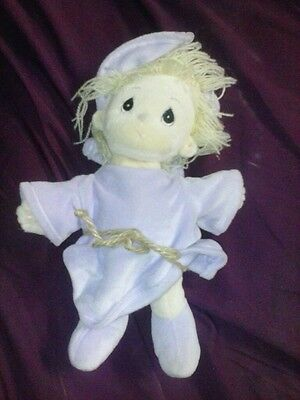 precious moments girl doll in puple robe cute and as the name suggests precious!