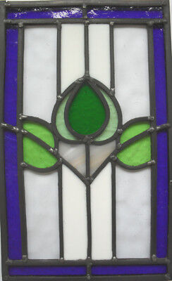 stained glass panel with variety of different glass