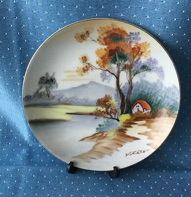 """UCAGCO China 6"""" plate hand painted Japan, signed K.Kato, Cottage by stream"""