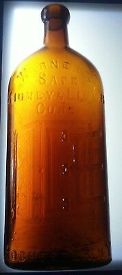 Antique Warner's Safe kidney & Liver Cure Rochester N Y Bottle Heavily Embossed
