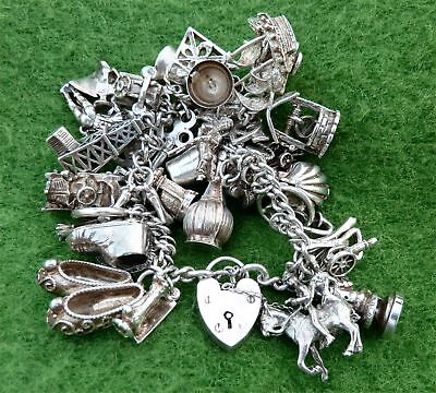VINTAGE 1970s SILVER CHARM BRACELET FEATURING 37 DIFFERENT SILVER CHARMS 3.43.oz