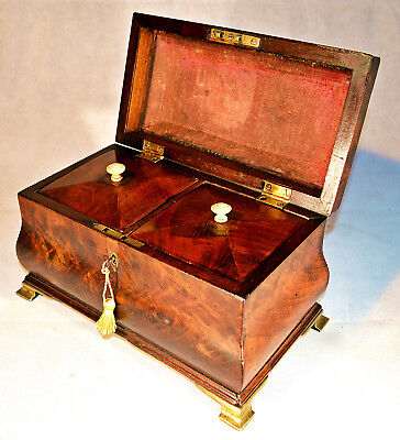 George III Flamed Mahogany Sarcophagus shaped Tea Caddy with two Lidded Division