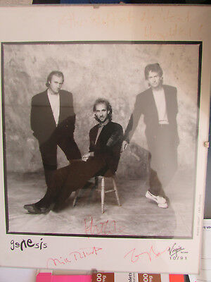 Autographed photo of Genesis by Mike Rutherford, Phil Collins and Tony Banks