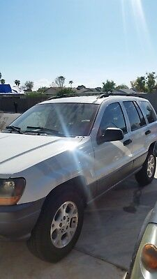 2001 Jeep Cherokee  2001 jeep grand  Cherokee Laredo  4x4  156,000 mi   super clean roof rack