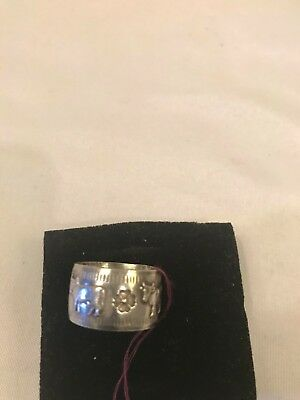 antique silver ring with Human and cow on it