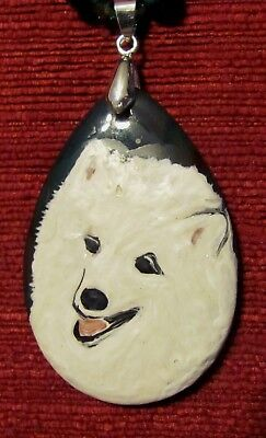 American Eskimo hand painted on an Onxy Agate pendant/bead/necklace