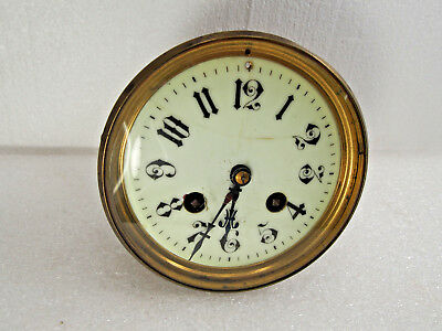 """Antique French mantel clock movement fits a 4 1/4"""" opening"""