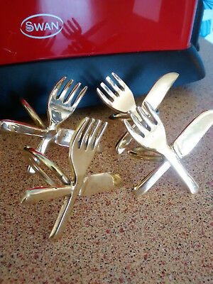 Set of 4 very unusual brass napkin rings knife/fork/cutlery