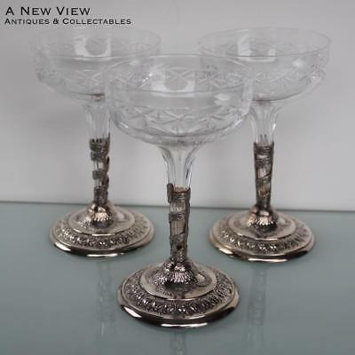 Three Art Nouveau silver plated crystal glass champagne glasses.