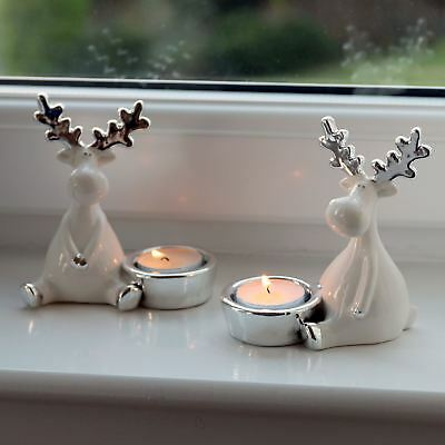Set of Two Ceramic Reindeer Xmas Tea Light Holders With Silver Detail 11cm Tall