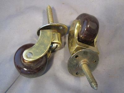 2 Old screw plate castors with porcelain wheels
