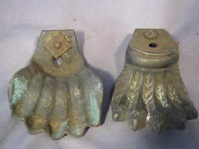 2 Old brass claw shaped feet.