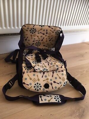 Munchkins Travel Booster Seat in excellent condition with carry Strap. Purple