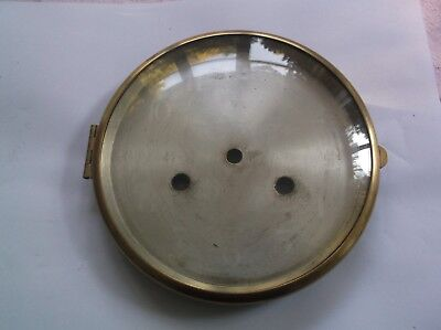 GLASS /BRASS RIM  FROM AN OLD   MANTLE CLOCK  OUTER 6 1/4 inch diam REF 19