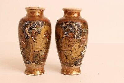 A very nice mirrored pair of japanese Satsuma thousand faces vases. 19th C.