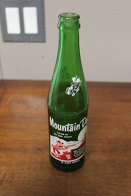 Vintage Hillbilly Mountain Dew bottle with Filled by name Irv and Smitty soda