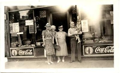 1930s Coca Cola sign on store with people in front snapshot