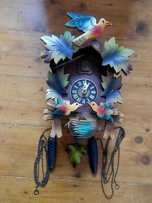 original vintage west German cuckoo clock.with moving birds