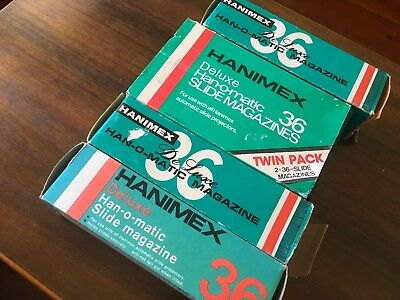 Four x HANIMEX HANOMATIC 35MM  SLIDE CARTRIDGES WITH SLIDES