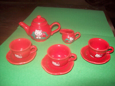 Sanrio Hello Kitty Red Ceramic Tea Set (1 Teapot, 3 Plates,3 Cups, Creamer)