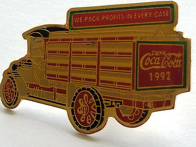 """Coca Cola - Drink Coca Cola 1992 - """" We Pack Profits In Every Case """" Pin."""