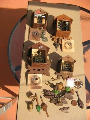 Four German Cuckoo Clocks with all parts shown in photos. For parts or repair