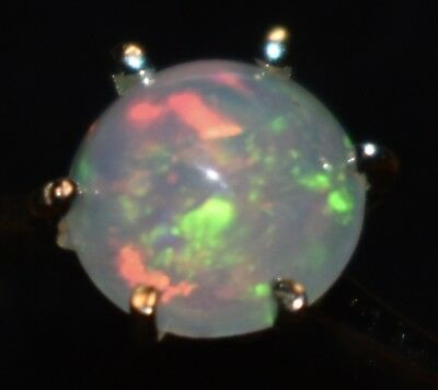 9k  GOLD OPAL RING  with a   BEAUTIFUL  SOLID CRYSTAL OPAL