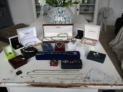 large collection of antique vintage and modern sterling silver jewellery..