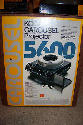 Kodak Carousel 5600 slide projector with screen, carousels, and Film-to-digital