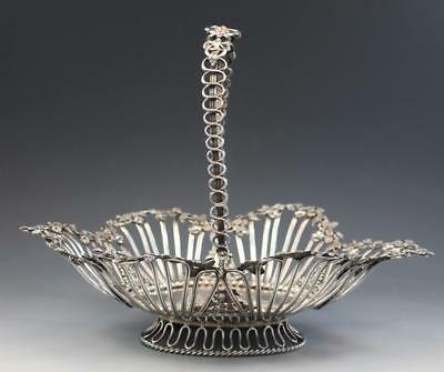 German 800 Silver Reticulated Handled Basket w/ Roses & Cherubs Flower Form