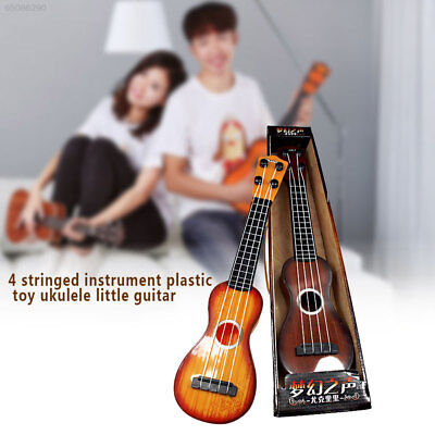 267E Child Kids Education Small Guitar Toy Mini Ukulele New Year Gift Beginners