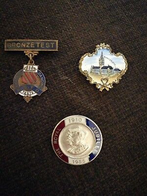 collection of three vintage badges
