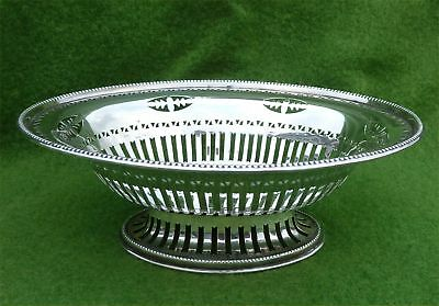 NICE PIERCED SILVER BASKET BY CHARLES & RICHARD COMYNS - LONDON 1925 - 4.75 ozt
