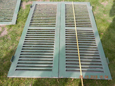 Pair of vintage French green window shutters.