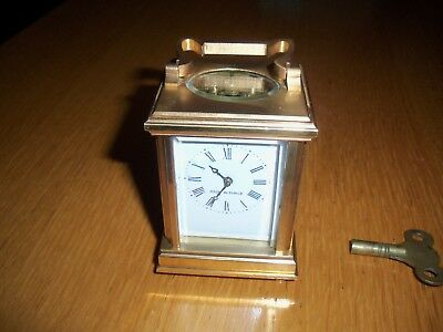 Tiny french brass carriage clock