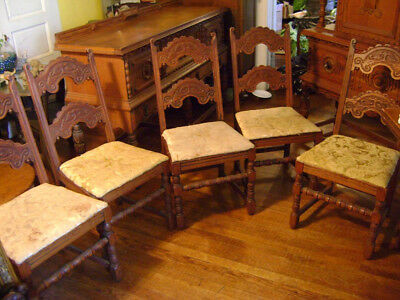 Vintage dining room chairs with detailed carving. Five antique wood chairs