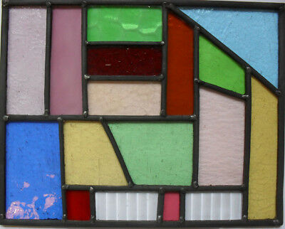 stained glass panel with variety of differing types of glass.