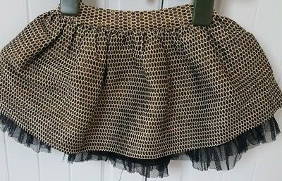 Baby girl Bows and Arrows skirt. Gold and Black. Age 9-12 months. Excellent cond