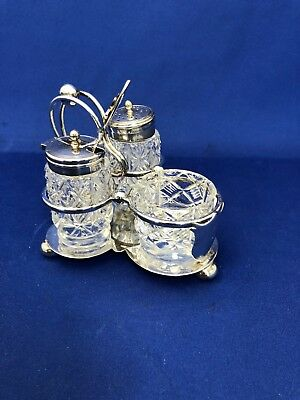 Five Piece Silver Plated Cruet Set with Cut Crystal Bottles and a Sterling Spoon