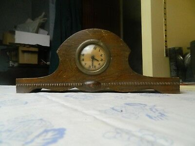 Vintage  small wooden cased mantle clock