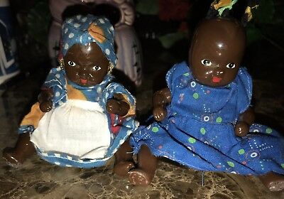 Pair black americana porcelain jointed dolls