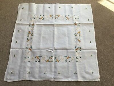 Hand stitched embroidered table cloth in white with colourful daisy's.